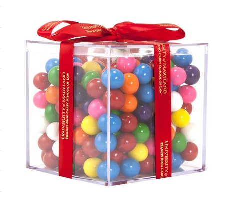 square clear acrylic container with multicolored gumballs and a red ribbon