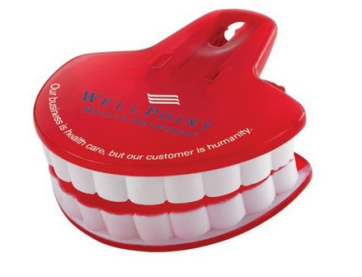 a red bag clip shaped like a toothy smile