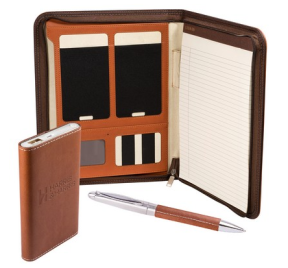 a brown organizer with matching pen and power pack for charging